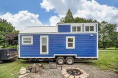 The Kokosing: a beautful blue tiny house from Modern Tiny Living of Columbus, Ohio. The 256 sq ft home has a modern/rustic aesthetic with all the comforts of home!
