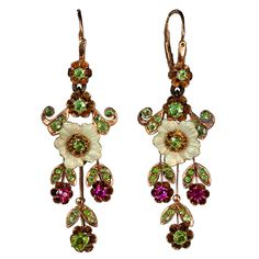 Russian Art Nouveau Enameled Demantoid Long Earrings  Russia  1908-1917  These delicate vintage Russian pendant earrings were made in Moscow between 1908 and 1917.     Handcrafted in 14K rose gold, decorated with finely enameled pearl white flowers, and set with 44 Uralian demantoids and 4 synthetic rubies.