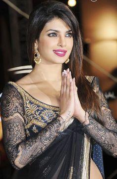 LOVE the detail lace sleeves on Priyanka Chopra