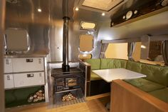 Ecostream interior.  Complete with wood burning stove, reclaimed police lockers as kitchen units and former Mini dashboard for entertainment.