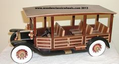 """1916  halack truck model    # 14 DH  this model is full of details: striped seats, two tone sides, a tool box and a crank.   Built from: genuine mahogany,black ebony, solid maple w / wheels and fenders painted black and the grill painted copper  Approx. size 14"""" Long X 10"""" Tall X 8"""" Wide"""