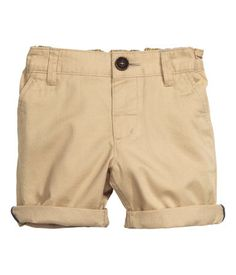 Shorts in soft, washed cotton twill. Adjustable elasticized waistband, fly with button, side pockets, and mock back pocket.