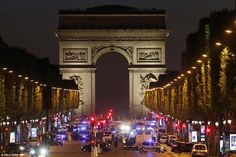 A French police officer was tonight shot dead on the Champs Elysees in Paris (pictured) - just as presidential candidates took part in a TV debate nearby