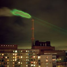 """""""Nuage Vert"""" (Green Cloud) by HeHe in Helsinki, represents the actual energy consumption of a coal burning power plant"""