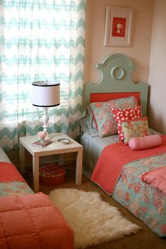 Coral, pink, and turquoise girls room.