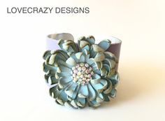 leather  cuff with handmade leather flower and by LoveCrazyDesigns