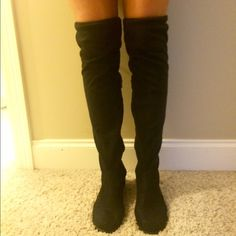 Thigh high over the knee faux suede boots These boots are super cute and have only been worn once for maybe 3 hours. They are just too big for me because I wear a 9. The ties in the back are fully adjustable so they will stay put above your knee. Bamboo Shoes Over the Knee Boots