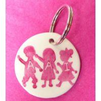 Porte clé rond Silhouettes des enfants personnalisable