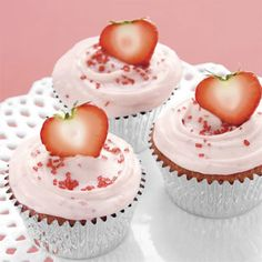 adorable pink strawberry cupcakes - I would hollow out the top of the strawberries a bit more to make a heart shape.