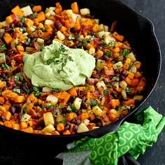 This healthy and tasty sweet potato hash, with black beans and bacon, pops with color and flavor, thanks to a creamy avocado sauce.
