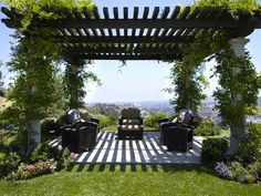 Planning A DIY Pergola... LOVE the plants growing up each corner post.