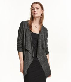 Light gray melange. Fine-knit cardigan in a soft fabric with a draped front section. Rolled edges at front and at cuffs. No buttons.
