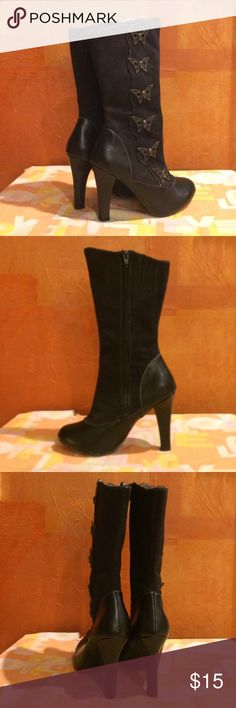 """FINAL SALE! EUC Demonia scary high-heeled boots Pre-loved, in good condition. Black calf-height boot. Heel 4"""", shaft approx 12.75"""" from arch, opening approx 14"""" around. Polyurethane heel/toe and suede-like microfiber shaft with metal tarnished bronze-colored butterfly skull """"buttons"""" down outside length. Inside zipper. A few very minor scuffs on heel/toe but not noticeable unless you look very close. Runs small, sticker says size 6 but they fit more like a  5. Demonia Shoes Heeled Boots"""