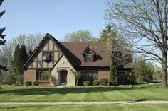 This romantic home style evokes a sense of old England. American Tudor style homes are built with visible timbers exposed as a design element (usually not structural, but decorative), with steeply pitched rooflines, and may have ornamental windows and leaded glass. These homes almost always have an exterior of stucco or brick. Tudor homes were typically built from the late 1800s through to the 1940s.