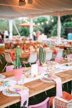 Love this modern and colorful western-inspired decor - cactus in hot pink pot + colorful place settings {GIDEON PHOTOGRAPHY}
