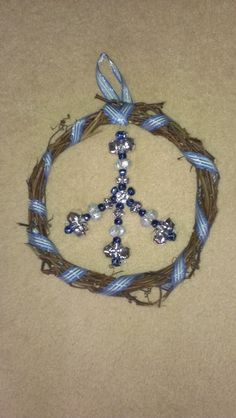 peace sign wreath, used grapevine from backyard. Made peace sign with bells. Attached with fishing line to make it look like it is floating in wreath