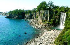 Photo of a waterfall and beach on Jeju Island, South Korea © manbeastextraordinaire