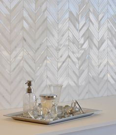 This would be gorgeous if it was a mother of pearl or capiz material for the backsplash.
