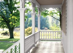 painted checkerboard patio or porch floors are simple yet sophisticated