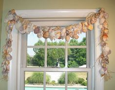 Seashell swag...Check out her clever hot glue and ornament hook idea to attach the seashells!--would be cool to put over the kids bathroom window to go with their beach design!