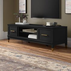 "The CosmoLiving by Cosmopolitan Westerleigh TV Stand is a stylish pedestal for the focal point of the room. Available in crisp white, graphite gray, or matte black, the Westerleigh is accented by trendy gold hardware with two doors and a fixed center shelf to store your top-notch equipment. This sturdy wooden stand holds TVs as heavy as 120 lbs and up to 65"" wide. Skip the electrical clutter and kick back after working nine to wine. Low Tv Stand, Tv Stand Set, Black Tv Stand, Wall Mount Tv Stand, Tv Stand Decor, Living Room Tv, Tv Stand Ideas For Living Room, Condo Living, Etagere Bookcase"