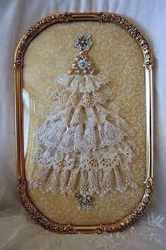 Christmas tree made of vintage lace and vintage jewelry in an ornate frame