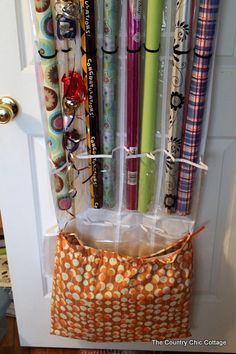 Dollar Store Organizing Ideas • Lot's of simple and inexpensive ideas, and tutorials, including this DIY gift wrap storage idea from 'Country Chic Cottage'!