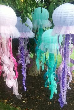 Jellyfish lanterns hanging decoration pink, purple, or aqua for under the sea party, Little Mermaid Party etc by DellaCartaDecor on Etsy https://www.etsy.com/listing/453599624/jellyfish-lanterns-hanging-decoration