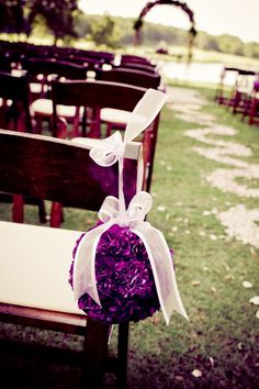 Purple floral ball for wedding aisle decor.  Photo by Jesse Reich Photography Blog.  #wedding #purple