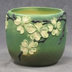 roseville dogwood   nouveau motif pottery ceramics clay