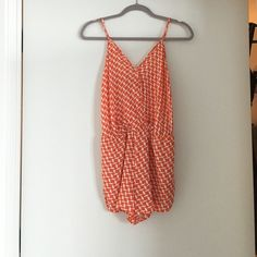 Boutique Orange Patterned Romper- Size Small Orange patterned romper. I got this in a boutique and have never actually worn it. The tags are no longer on it. The shorts are a little too short for me to feel comfortable in even though I thought it was cute at the time... Other