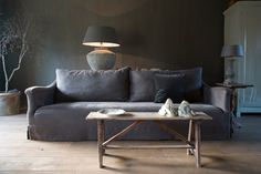 natural home styling, want that sofa!