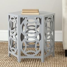 @Overstock - What's good is good. Embrace circular logic with the Natanya side table. This chic accent piece adds contemporary charm with interlocking circles and the clean lines of its hexagonal tabletop. Perfect for classic interiors that need a punch.http://www.overstock.com/Home-Garden/Safavieh-Natanya-Pearl-Blue-Grey-Side-Table/7827757/product.html?CID=214117 $176.99