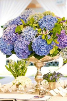 silver vessel makes these blue and purple hydrangea blooms / http://www.himisspuff.com/beautiful-hydrangeas-wedding-ideas/8/