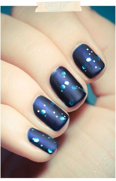 pretty mani - love the base blue (an essie color - midnight cami); then a glitter top coat, with a matte top coat over it all.