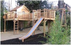 2 station platform treehouse with x cedar cottage, slide, tyre swing, wooden swing, climbing wall and fireman's pole