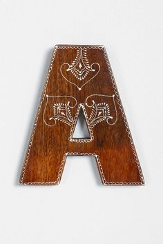 Magical Thinking Henna Letter 2 for $20. I would love these to spell out PRAY on my wall :)