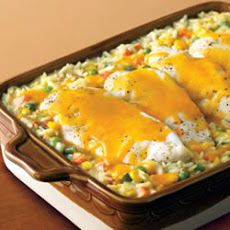 Campbell's® Cheesy Chicken and Rice Casserole Recipe: 4 boneless skinless breasts boiled in chicken base and poultry seasoning then shredded, 1 box long grain wild rice, 1-3/4 cup chicken broth, 1 bag mixed veggies, 1 cup cheddar cheese, 3 tsp chicken base, 1 tsp mrs. Dash garlic herb plus a little more, 1 can cream soup....mix together, pour in greased 9x13 and bake at 375 for 45 min.