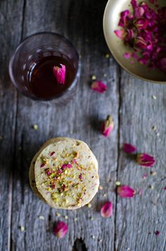 pistachio & rose cookies makes 60     250 g unsalted butter, softened ¾ cup vanilla caster sugar 1 egg 2 tsp rose water 2½ cups plain flour 70 g ground pistachio's, plus extra to garnish 3 tbsp dried rose petals