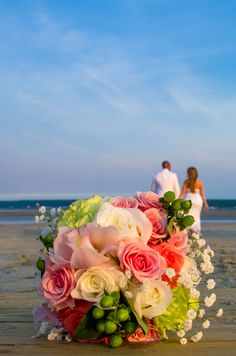 ivory, pink, coral wedding bouquet with a touch of green