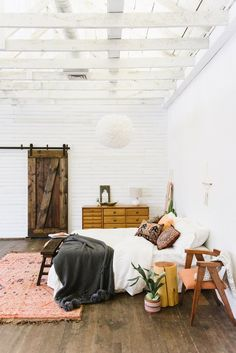 airy, colorful bedroom with barn doors