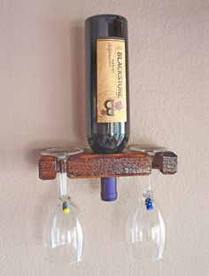 Hand made wall mount single bottle wine display. Perfect for a favorite prize wine bottle or spirits display. Hand made in USA.