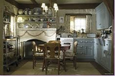 Kate Winslet's character's kitchen in her wee English bungalow in The Holiday. Love the huge fireplace and display shelves, not so much the tiny range.
