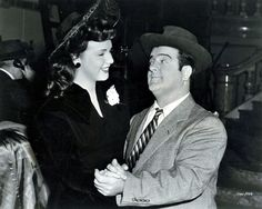 LET'S DANCE: Deanna Durbin takes Lou Costello for a spin on the dance floor.