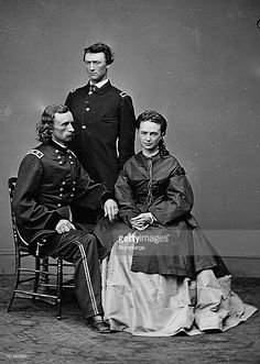 circa 1864: George is seated on the left, his wife, Libbie Custer, and his brother Tom Custer is pictured standing. Tom Custer also died at the Battle known as 'Custer's Last Stand', or 'The Battle of Little Big Horn'.