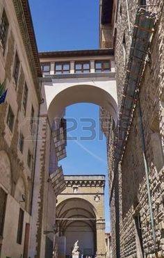 View of Vasari Corridor and loggia dei Lanzi from Neri street, Florence, Italy
