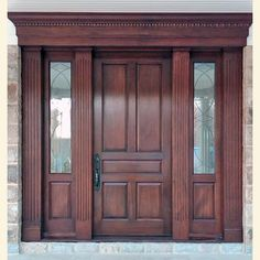 5 panel door with custom leaded glass sidelites, custom fluted pilasters, crown and dental detail