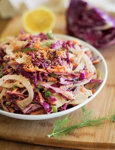 This mayo-free fennel and cabbage slaw is fresh, zesty and flavorful. Perfect for putting on your hamburgers, tacos, sandwiches, or for serving as a side. Fennel Recipes, Slaw Recipes, Raw Food Recipes, Veggie Recipes, Vegetarian Recipes, Cooking Recipes, Healthy Recipes, Picnic Recipes, Picnic Ideas