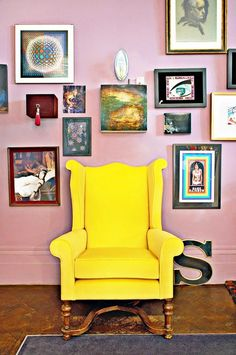 Pink living room with art and yellow sofa. #decor #decoration #interior #livingroom #home #wall #photograph #painting #