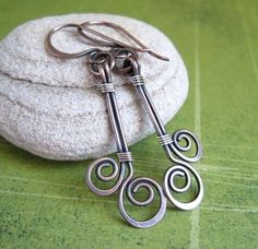 nice as earrings or could be wrapped together with a bead drop between 'em for a pendant...